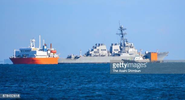 The process to load damaged USS Fitzgerald on to Heavy Load Carrier Transshelf continues off Yokosuka on November 24 2017 in Yokosuka Kanagawa Japan...