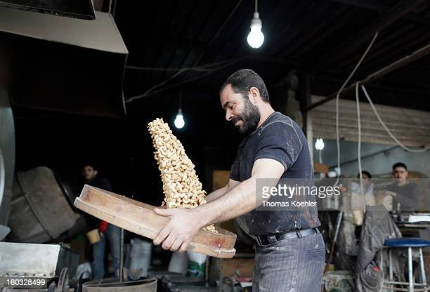 The processing of roasted cashew nuts which along with other various seeds and nuts are a popular snack food with the Lebanese people pictured on...