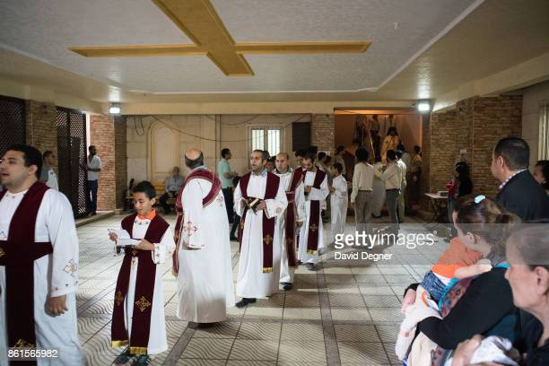 The procession around the church after mass inside the Holy Family Orthodox Church in Zeitoun during Holy Week on April 13 2017 in Cairo Egypt