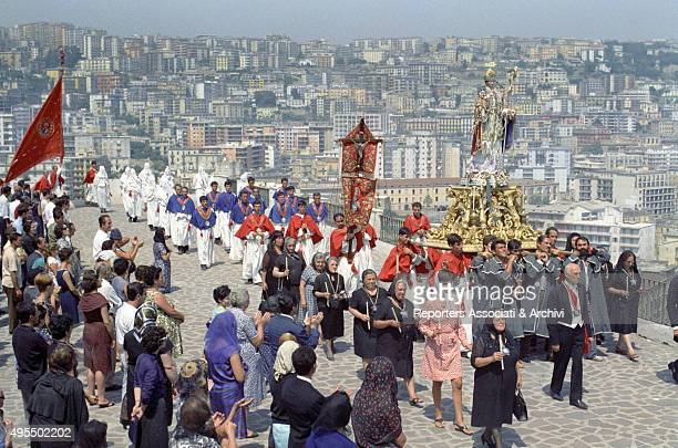 The procession for Saint Januarius 's feast in a scene from the film Treasure of San Gennaro Naples 1966