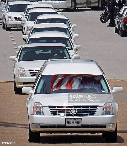 The procession heads to the National cemetery during funeral services for Dallas Police officer Patrick Zamarripa one of five officers shot to death...
