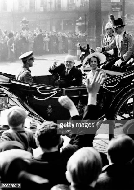 The Procession of French president Vincent Auriol and his wife Michelle Auriol surrounded by the House Guards is cheered by the crowd on March 9 1950...