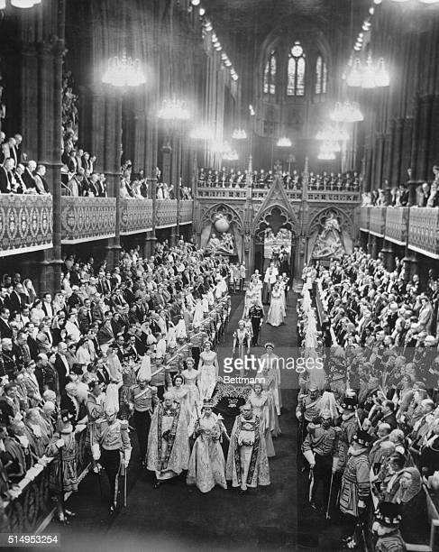 The procession of Queen Elizabeth II approaches the Great West Door of Westminster Abbey on the way out after Coronation services She is flanked by...