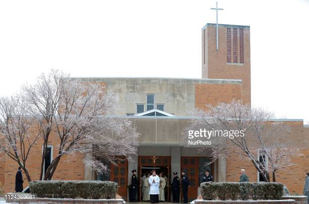 The procession of the casket to the hearse begins after the funeral service of the longest-serving member of congress, John Dingell at the Church of...