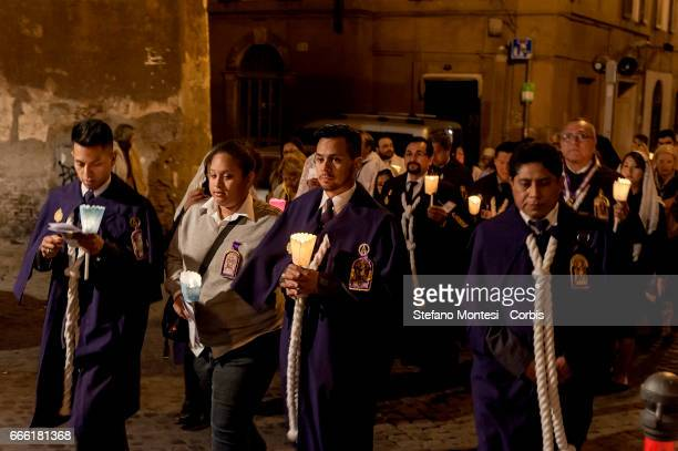 The procession of the Via Crucis of the Christian brotherhoods proceeds through the streets of the old town on April 7 2017 in Rome Italy The...