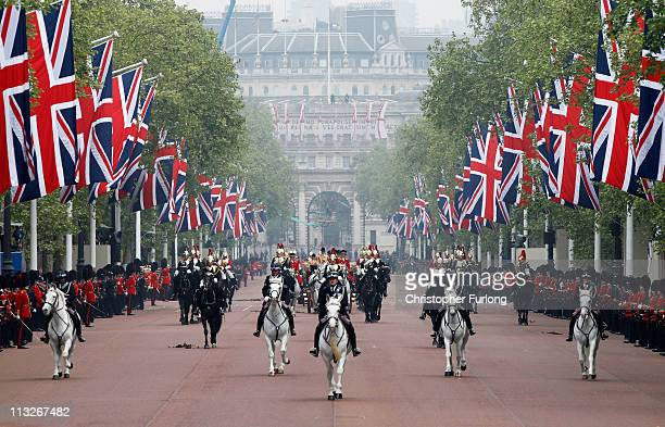The procession of TRH Prince William Duke of Cambridge and Catherine Duchess of Cambridge make the journey by along the Mall to Buckingham Palace...