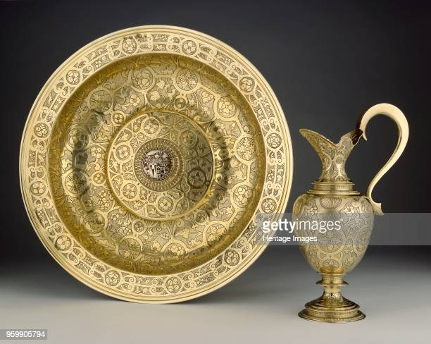 The Proctor basin 15921593 Chased with strapwork and leaves and flowers in the centre is an inserted box enamelled in red and black with a shield of...