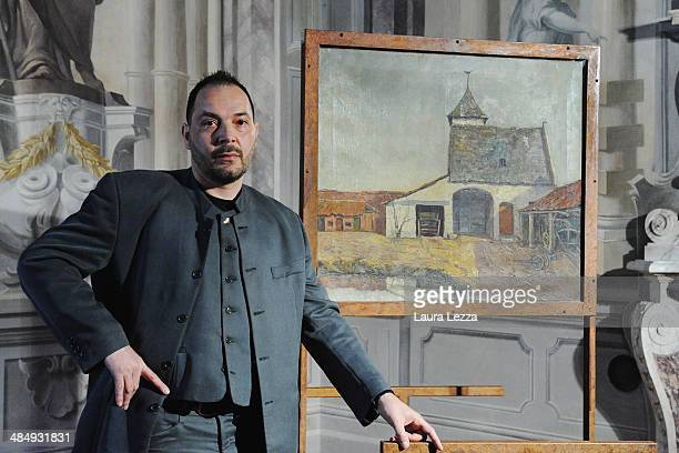 The procurator of the painting 'The Protestant Barn' Massimo Mascii poses for a photo ahead of the press conference for the exhibition 'Vincent Van...