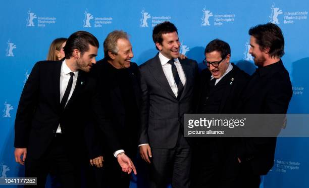 The producer Matthew Budman producer Charles Roven the actor Bradley Coopper the director David O Russell and the actor Christian Bale pose during...