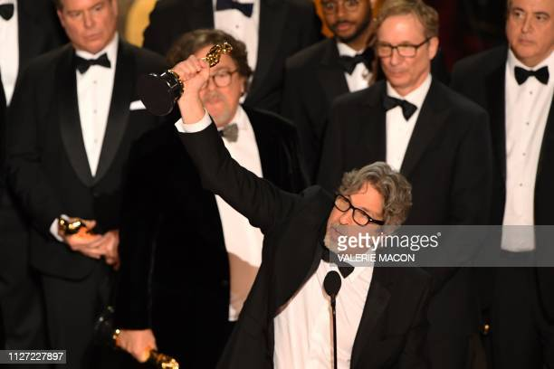 TOPSHOT The producer of Best Picture nominee Green Book Peter Farrelly accepts the award for Best Picture with the whole crew on stage during the...