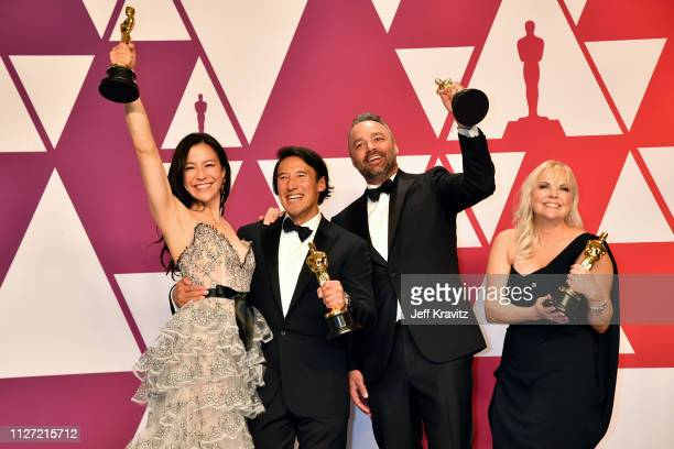 The producers of Free Solo Elizabeth Chai Vasarhelyi Jimmy Chin Evan Hayes and Shannon Dill pose with the award for Best Documentary Feature in the...