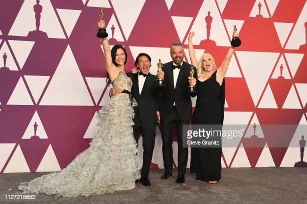 The producers of 'Free Solo' Elizabeth Chai Vasarhelyi Jimmy Chin Evan Hayes and Shannon Dill pose with the award for Best Documentary Feature in the...