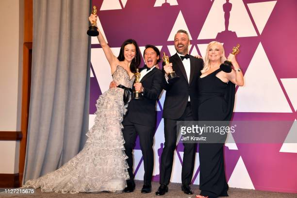 The producers of Free Solo pose with the award for Best Documentary Feature in the press room during at Hollywood and Highland on February 24 2019 in...