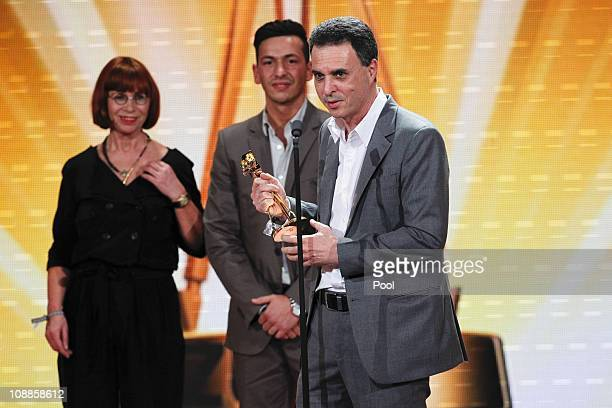 The producers of the film 'Zivilcourage' pose with the golden camera during the 46th Golden Camera awards at the Axel Springer Haus on February 5...