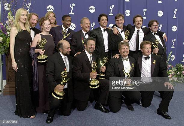 The producers writers and cast of West Wing pose with their awards for Outstanding Drama Series backstage at the 52nd Annual Primetime Emmy Awards...