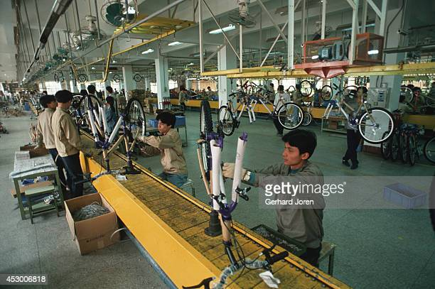 The production line of Diamond Back mountain bikes at the China Bicycle Company in Shenzhen Economic Zone