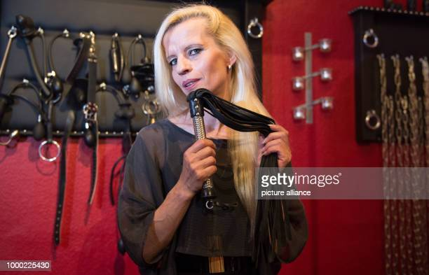 The professional dominatrix Lady Jana looks into the camera at her studio DAS in Hamburg Germany 22 June 2017 Photo Axel Heimken/dpa