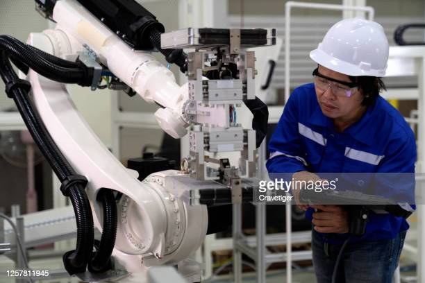 the professional engineer use heavy automation robot arm machine in smart factory industrial with vision sensor system application. industry 4th iot concept - deep learning stock pictures, royalty-free photos & images