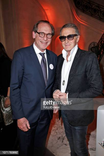 the Professor Gerard Friedlander and Eric Pfrunder are photographed for Paris Match at the evening gala Sauver La Vie for the Medical University...
