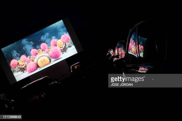 The projection screen is reflected in the windows of cars at the Drivein Cinema in Denia on May 14 becoming the first cinema to open at thirty...