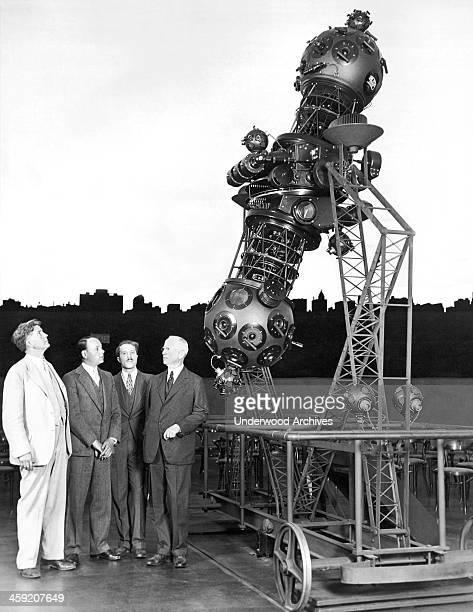 The projector at the newly finished Adler Planetarium Chicago Illinois May 6 1930 LR are Professor Phillip Fox first director of the planetarium...