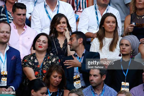 The Projects hosts Lisa Wilkinson and Waleed Aly and Aly's wife Susan Carland watch the women's singles final between Caroline Wozniacki of Denmark...