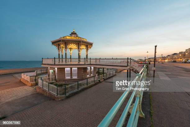 The Promenade and Bandstand, Brighton, Illuminated at Sunset.