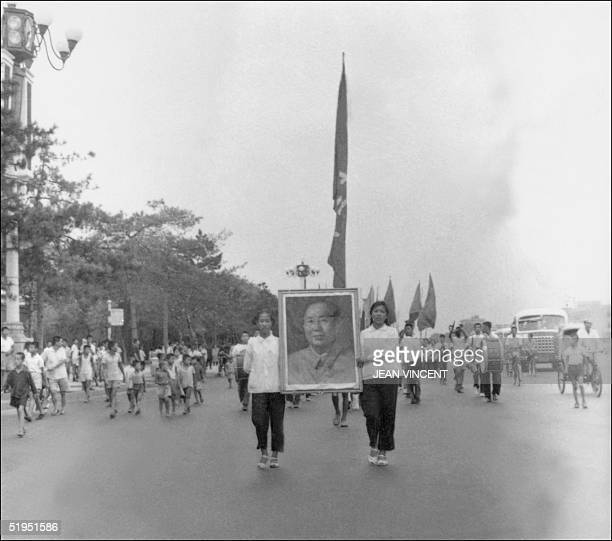 The propaganda squad of Red Guards high school and university students carry the portrait of Chairman Mao Zedong parade in June 1966 on Chang'an...
