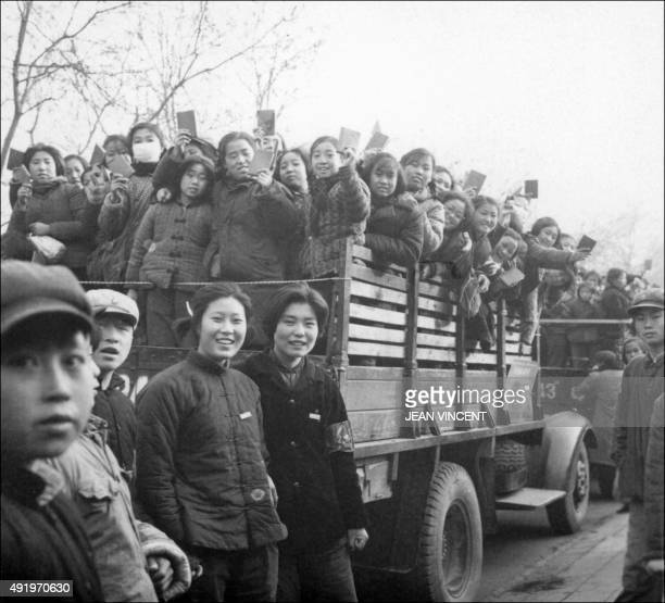 The propaganda squad of Red Guards high school and university students brandishing the copies of Chairman Mao Zedong's Little Red Book parade in late...