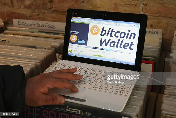 The proprietor of a shop selling vinyl records and that accepts Bitcoins for payment brings up at the request of the photographer the Bitcoins...