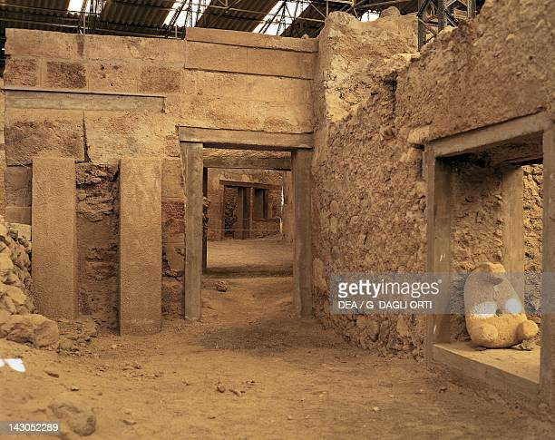 The propylon with entrances to the houses at the archaeological site of Akrotiri on Thera now Santorini Greece Minoan civilization 16th Century BC