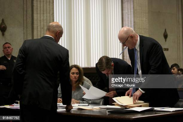 The prosecution table from left Joseph McMahon Jody Gleason Dan Weiler and Jospeh Cullen pore over paperwork at a hearing for Chicago police Officer...