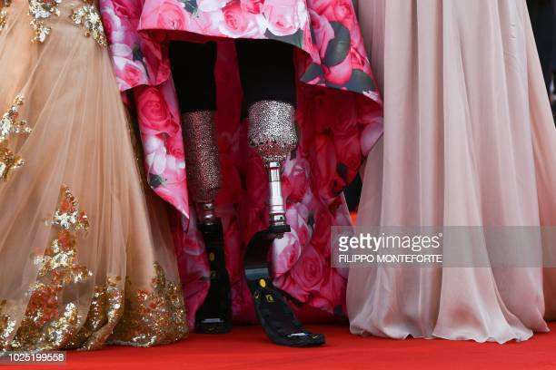 The prosthetic legs of paralympic athlete Giusy Versace are pictured as she arrives for the opening ceremony of the 75th Venice Film Festival and the...