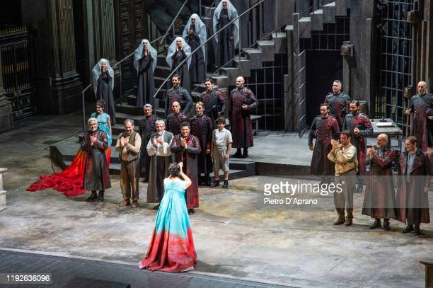 """The protagonist Anna Netrebko and the cast of the opera """"La Tosca"""" during the final applauses the """"Prima Alla Scala"""" at Teatro Alla Scala on December..."""