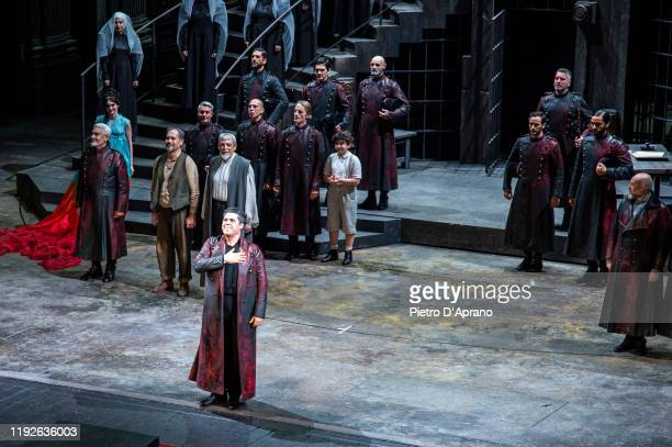 """The protagonist Luca Salsi and the cast of the opera """"La Tosca"""" during the final applauses the """"Prima Alla Scala"""" at Teatro Alla Scala on December..."""