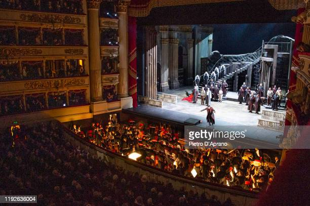 The protagonist Luca Salsi and the cast of the opera La Tosca during the final applauses the Prima Alla Scala at Teatro Alla Scala on December 07...