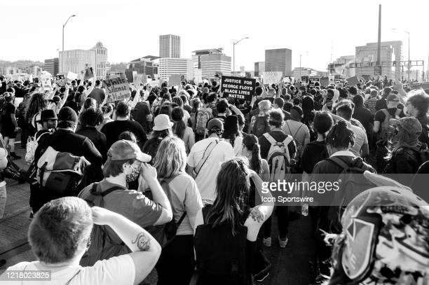 The protest of several thousand people marches on through the Morrison Bridge on June 3 in Portland OR The protest was organized to voice concerns...