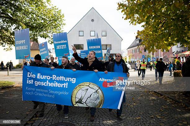 FREILASSING BAVARIA GERMANY The protesters against refugees and Merkel shout and bring banner during a protest
