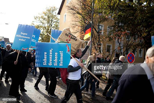 FREILASSING BAVARIA GERMANY The protesters against refugees and Merkel shout Secure borders secure homeland