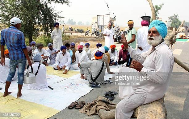 The protesters blocked the BathindaKotkapura highway at Behbal Kalan during protest over the sacrilege of Guru Granth Sahib on October 20 2015 in...