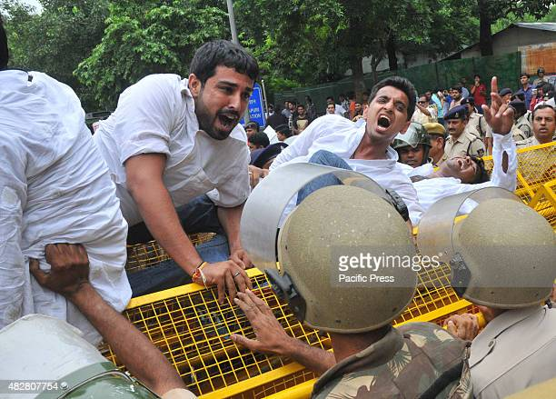 The protesters clash during a protest against Prime Minister Nawaz Sharif and Abdul Qadeer Indian youth trying to pass through as they launched...