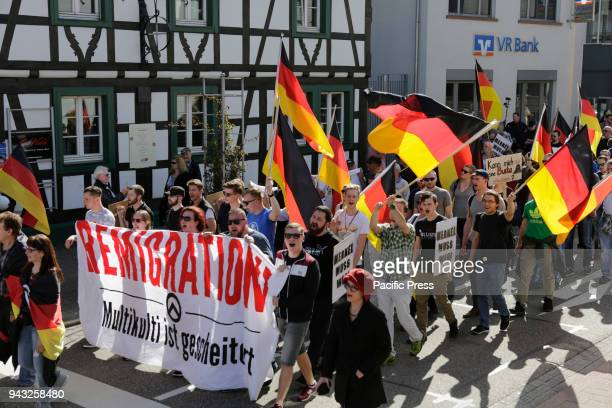 The protesters march with flags and banners through Kandel Around 500 people from rightwing organisations protested in the city of Kandel in...