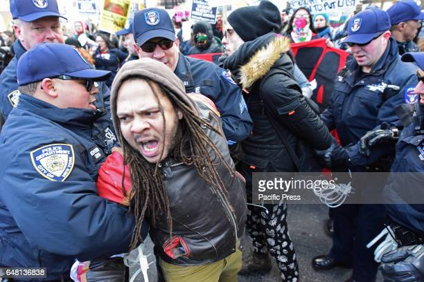 The protesters were seized by the policemen An estimated one thousand activists gathered in front of the New York City Public Library Main Branch for...