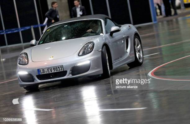 The prototype of a Porsche Boxster E driving through a fair hall during a conference on electro mobility in Leipzig Germany 14 April 2016 PhotoJan...