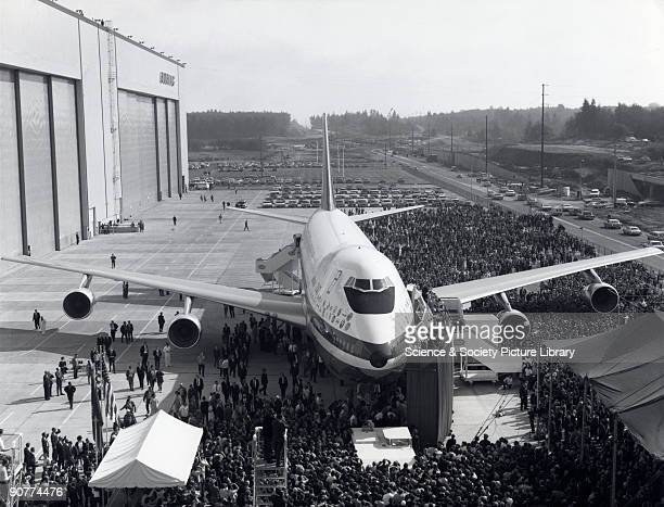The prototype of the 'Jumbo' being rolled out of its purposebuilt factory the largest building ever built at Everett Washington USA The world's...