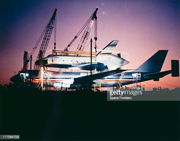The prototype Space Shuttle Enterprise is mounted on the Boeing 747 Shuttle Carrier Aircraft before an approach and landing test at Edwards Air Force...