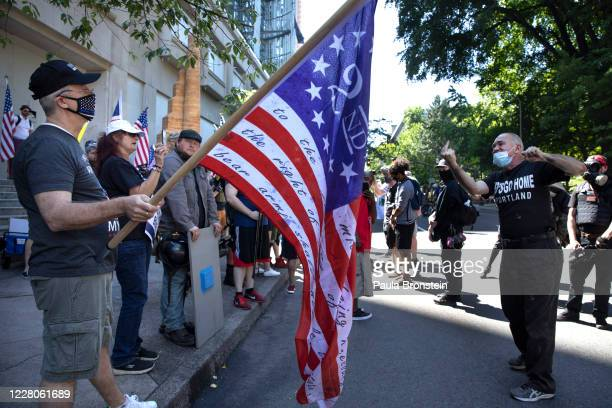 The Proud Boys, an alt-right group, face off with Black Lives Matter protesters on August 15, 2020 in downtown Portland, Oregon. Demonstrations have...