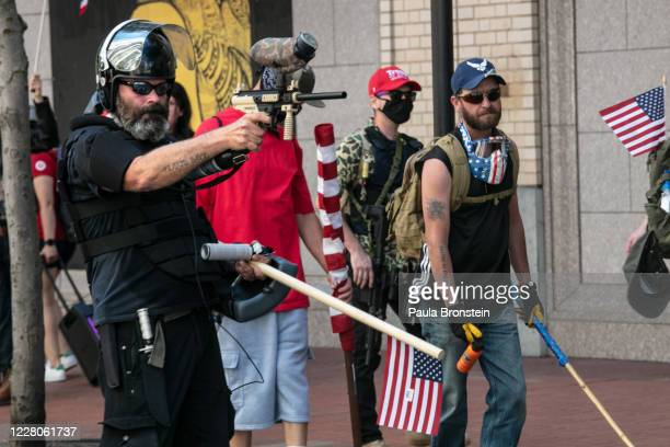 The Proud Boys, an alt-right group, faces off against Black Lives Matters protesters using mace and a paint ball gun on August 15, 2020 in downtown...