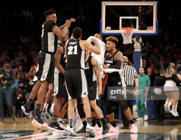 The Providence Friars celebrate the 7572 overtime win over the Xavier Musketeers during semifinals of the Big East Basketball Tournament at Madison...