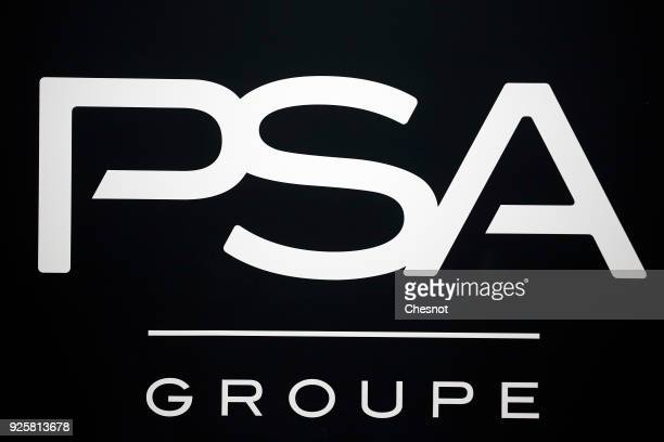 The PSA logo is pictured prior to a press conference of PSA Group to announce the company's 2017 annual results at their headquarters on March 1 2018...